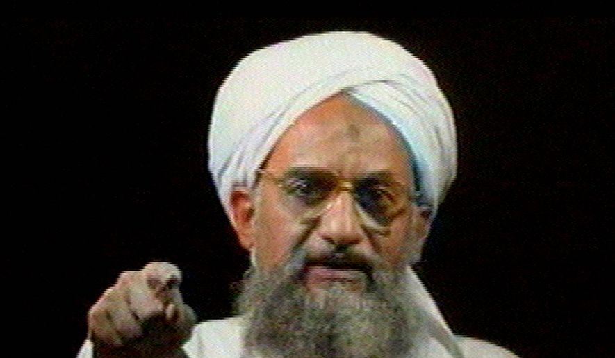 In this file image from television transmitted by the Arab news channel Al-Jazeera on Monday,  Jan. 30, 2006, Al Qaeda's then deputy leader Ayman al-Zawahri gestures while addressing the camera. (AP Photo/Al-Jazeera, File)