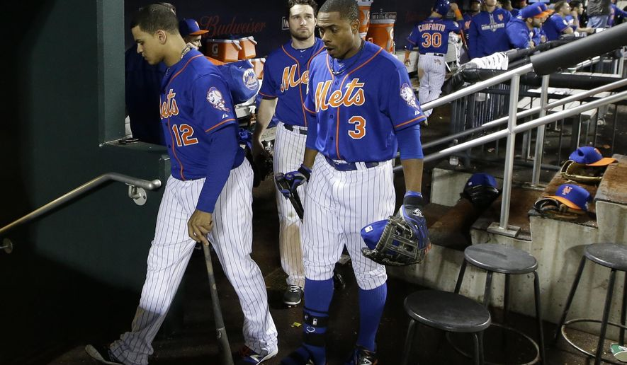 Members of the New York Mets leaves the dugout after their loss to the Kansas City Royals in Game 5 of the Major League Baseball World Series Monday, Nov. 2, 2015, in New York. The Royals won 7-2 to win the series. (AP Photo/David J. Phillip)