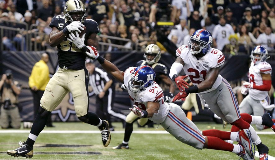 New Orleans Saints tight end Benjamin Watson (82) pulls in a touchdown pass in in front of New York Giants free safety Landon Collins (21) and outside linebacker Devon Kennard (59) the second half of an NFL football game in New Orleans, Sunday, Nov. 1, 2015.  (AP Photo/Butch Dill)