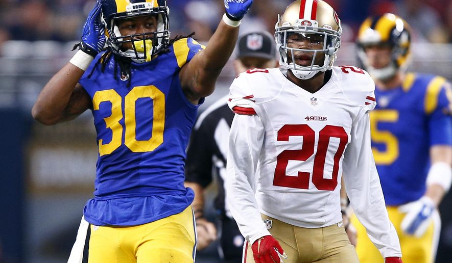 St. Louis Rams running back Todd Gurley, left, celebrates after running for a first down as San Francisco 49ers cornerback Kenneth Acker watches during the third quarter of an NFL football game, Sunday, Nov. 1, 2015, in St. Louis. (AP Photo/Billy Hurst)