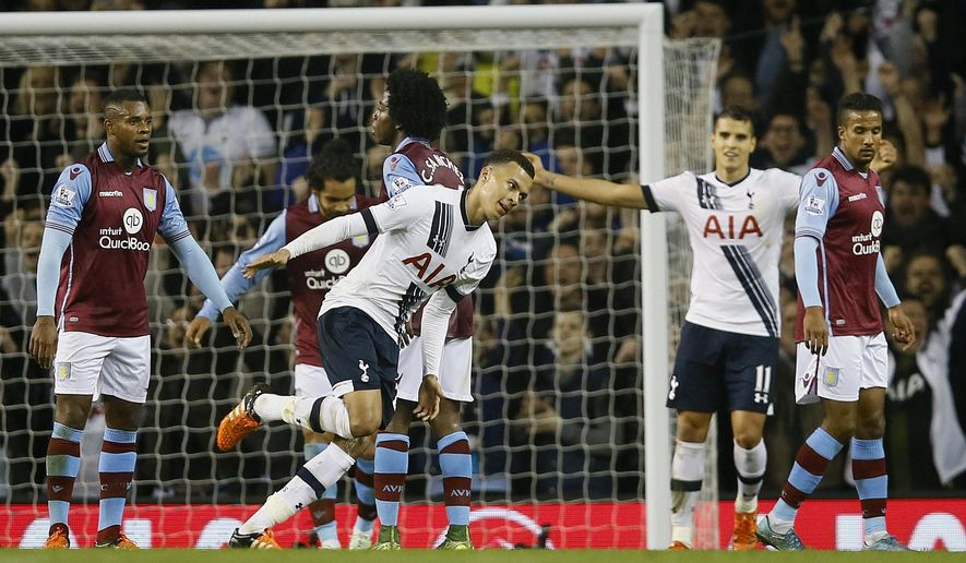 Tottenham's  Dele Alli, centre, celebrates after he scores a goal during the English Premier League soccer match between Tottenham Hotspur and Aston Villa at White Hart Lane stadium in London, Monday, Nov. 2, 2015. (AP Photo/Kirsty Wigglesworth)