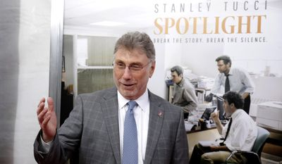 """In this Wednesday, Oct. 28, 2015, file photo, Marty Baron, former editor of The Boston Globe, walks the red carpet as he attends the Boston area premiere of the film """"Spotlight"""" at the Coolidge Corner Theatre, in Brookline, Mass. (AP Photo/Steven Senne, File)"""