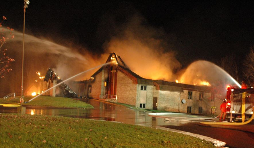 In this Oct. 31, 2015 photo, firefighters work to put out a fire at Salem Baptist Church in Ashland, Wis. The church sustained heavy damage. Police say the roof collapsed. (Rick Olivo/The Ashland Daily Press via AP) MANDATORY CREDIT
