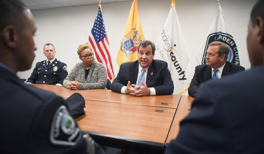 From left, Chief Scott Thomson, Mayor Dana Redd, Governor Chris Christie and Camden County Freeholder Director Louis Cappelli take part in a round table discussion with community leaders and Camden County Police Officers at police headquarters in Camden, N.J., Monday, Nov. 2, 2015. (John Ziomek/Camden Courier-Post via AP)