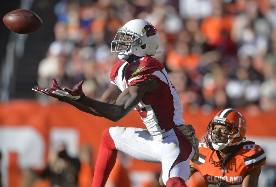Arizona Cardinals wide receiver Jaron Brown (13) catches the ball for a first down as Cleveland Browns defensive back Tramon Williams (22) watches in the second half of an NFL football game, Sunday, Nov. 1, 2015, in Cleveland. (AP Photo/David Richard)