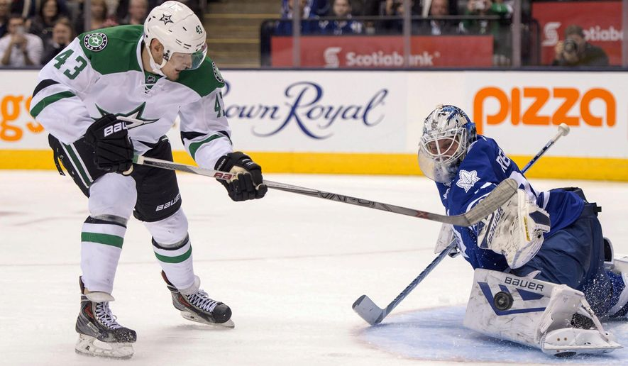 Toronto Maple Leafs goaltender James Reimer makes a save on a penalty shot by Dallas Stars right winger Valeri Nichushkin during third period of an NHL hockey game in Toronto, Monday, Nov. 2, 2015. (Frank Gunn/The Canadian Press via AP) MANDATORY CREDIT