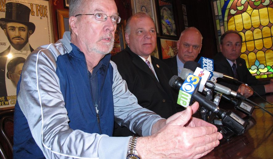 FILE _ In this March 19, 2014 file photo, New Jersey state Sen. James Whelan, left, speaks at a news conference in Atlantic City N.J. On Monday Nov. 2, 2015, Whelan said he will introduce a bill to regulate daily fantasy sports betting in New Jersey. (AP Photo/Wayne Parry, File)