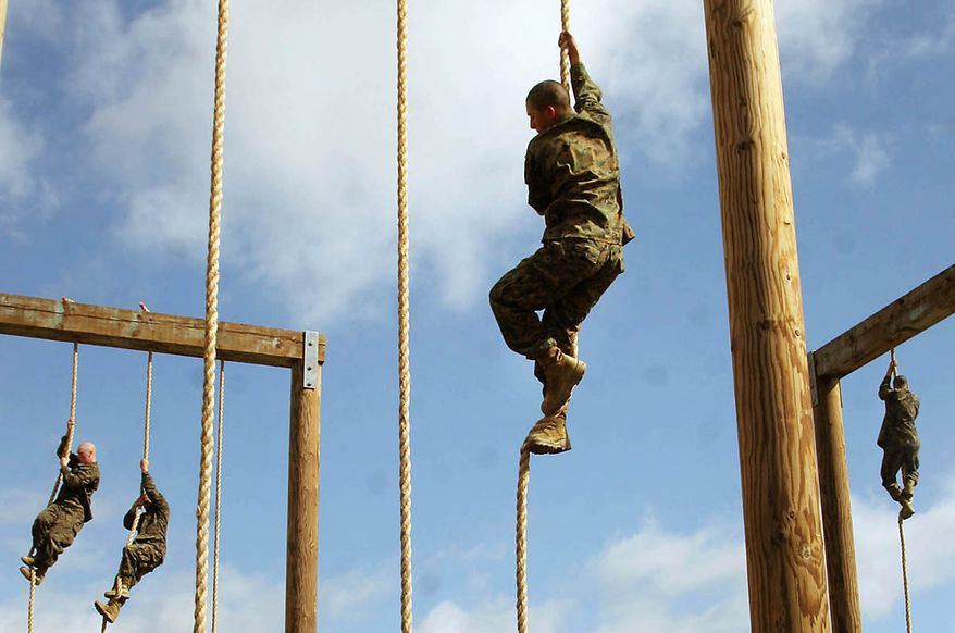 Recruits of Company D, 1st Recruit Training Battalion, climb a rope as their last segment of the obstacle course aboard Marine Corps Recruit Depot San Diego Feb. 28. After the rope climbing, recruits were required to conduct fireman's carries and buddy drags.  (U.S. Marine Corps photo by Cpl. Walter D. Marino)
