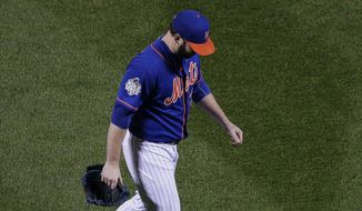 New York Mets starting pitcher Matt Harvey leaves the game against the Kansas City Royals during the ninth inning of Game 5 of the Major League Baseball World Series Sunday, Nov. 1, 2015, in New York. (AP Photo/Peter Morgan)