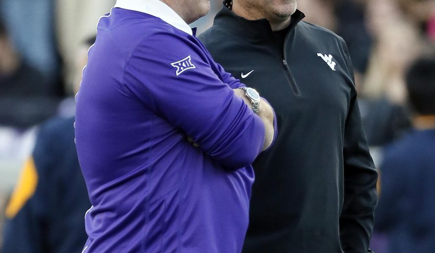 TCU head coach Gary Patterson, left, and West Virginia head coach Dana Holgorsen, right, talk on the field before NCAA college football game Thursday, Oct. 29, 2015, in Fort Worth, Texas. (AP Photo/Tony Gutierrez)