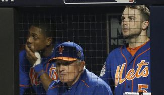 New York Mets manager Terry Collins watches with David Wright, right, the 11th inning of Game 5 of the Major League Baseball World Series against the Kansas City Royals Sunday, Nov. 1, 2015, in New York. (AP Photo/Matt Slocum)