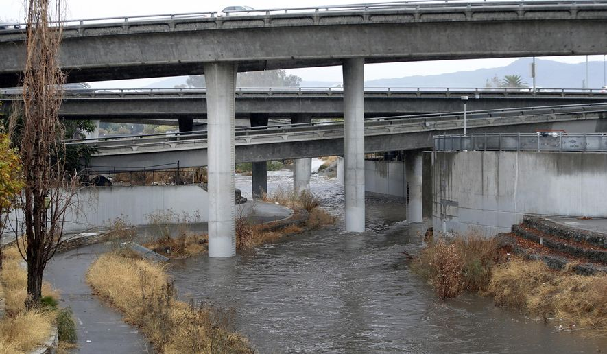 A morning soaking brought the Guadalupe River back to life, as it flows Monday, Nov. 2, 2015, under the Interstate 280 overpass in San Jose, Calif. The first winter-like storm of the season brought rain and snow to California on Monday, triggering traffic accidents including a 20-vehicle crash in the southern San Joaquin Valley. (Karl Mondon/Bay Area News Group via AP)
