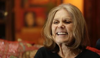 Gloria Steinem talks to a reporter at her home in New York in this Monday, Oct. 19, 2015, file photo. (AP Photo/Seth Wenig) ** FILE **