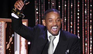 """Will Smith accepts the Hollywood actor award for """"Concussion,"""" at the Hollywood Film Awards at the Beverly Hilton Hotel on Sunday, Nov. 1, 2015, in Beverly Hills, Calif. (Photo by Chris Pizzello/Invision/AP)"""