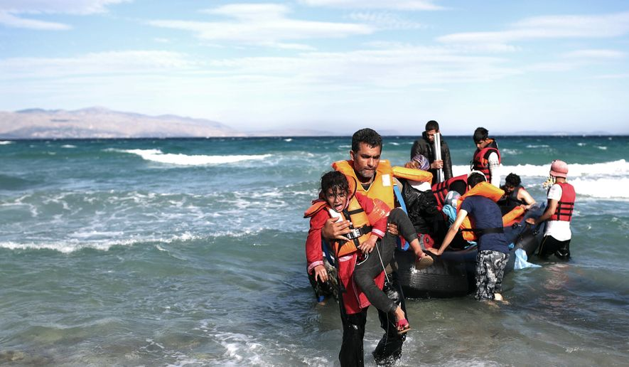 Migrants disembark from a dinghy after they cancelled their journey because of bad weather to travel to the Greek island of Chios from Turkish coast near Cesme, Izmir, Turkey, Tuesday, Nov. 3, 2015. More than 300,000 people have traveled on dinghies and boats from nearby Turkey to Greek islands this year, with dozens dying along the way. (AP Photo/Emre Tazegul) ** FILE **