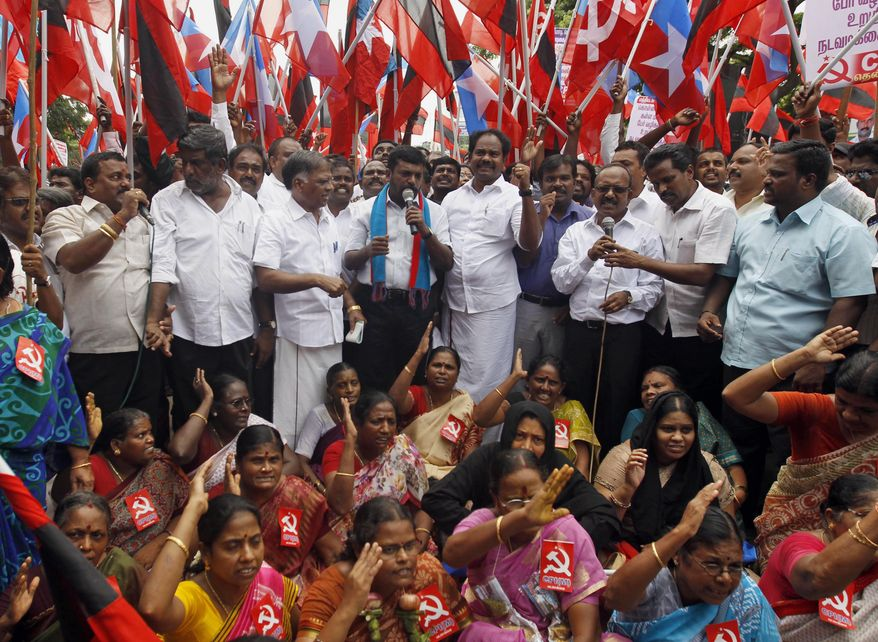 Members of Communist Party of India and Liberation Panthers participate in a protest in Chennai, India, Tuesday, Nov. 3, 2015. An international rights group on Tuesday demanded the release of an Indian folk singer arrested S. Kovan on charges including sedition for writing songs criticizing a state official for not banning liquor sales. (AP Photo/Arun Sankar K.)