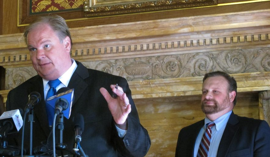Democratic state Rep. Andy Jorgensen speaks out at a news conference, with Rep. Cory Mason watching, against Republican bills targeting fraud in Wisconsin's food stamp program up for debate in the Assembly on Tuesday, Nov. 3, 2015, in Madison, Wis.  Opponents to the bills say they aren't needed and will only make it more difficult for people in need of food to receive it. (AP Photo/Scott Bauer)