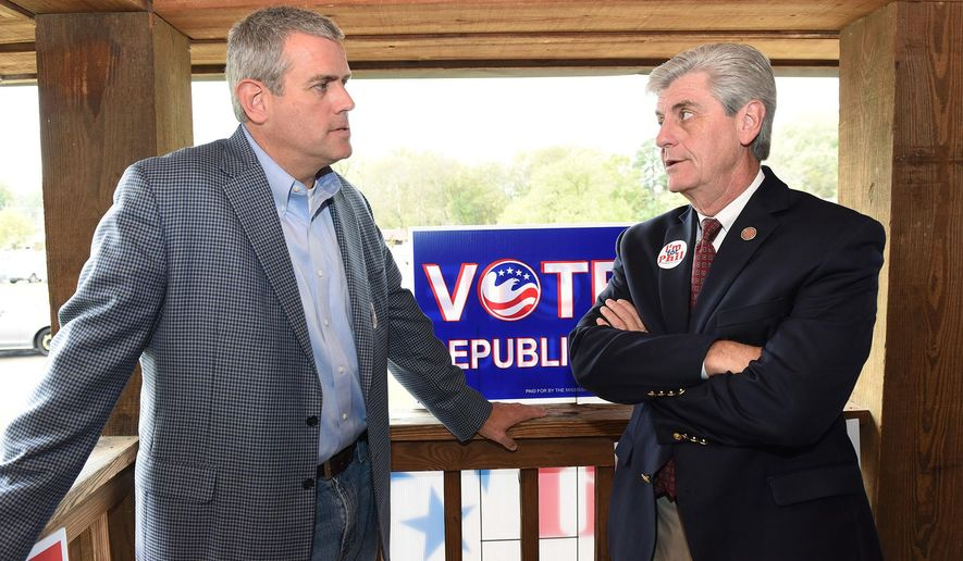 Mississippi Gov. Phil Bryant, right, talks with Speaker of the Mississippi House of Representatives Philip Gunn during a Republican pre-election day rally on Monday, Nov. 2, 2015, at the Mississippi Agriculture and Forestry Museum in Jackson, Miss. (Joe Ellis/The Clarion-Ledger via AP)  NO SALES; MANDATORY CREDIT