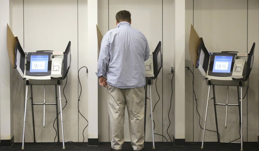 A person votes Tuesday, Nov. 3, 2015, in Salt Lake City. Two-term Salt Lake City Mayor Ralph Becker hopes to beat back a challenge Tuesday from former state lawmaker Jackie Biskupski as he seeks another term leading Utah's capital city. (AP Photo/Rick Bowmer)