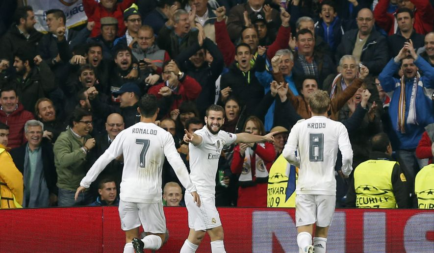 Real Madrid's Nacho Fernandez, center, reacts with Real Madrid's Cristiano Ronaldo, left, and Real Madrid's Toni Kroos after scoring the opening goal during their Group stage of Champion's League Group A soccer match against Real Madrid at the Santiago Bernabeu stadium in Madrid, Spain, Tuesday, Nov.3, 2015. (AP Photo/Daniel Ochoa de Olza)