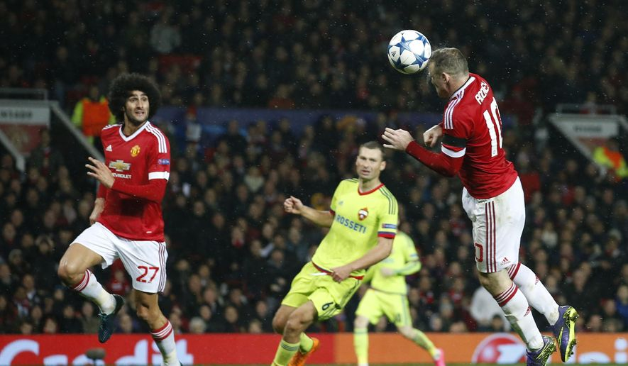 Manchester United's Wayne Rooney heads the ball scoring the opening goal during the Champions League Group B soccer match between Manchester United and CSKA Moskva at Old Trafford Stadium, Manchester, England, Tuesday, Nov. 3, 2015. (AP Photo/Jon Super)