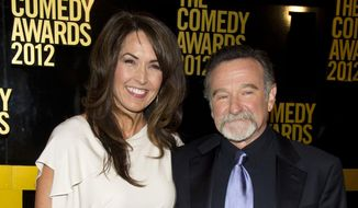 Robin Williams, right, and his wife Susan Schneider arrive to The 2012 Comedy Awards in New York, in this April 28, 2013, file photo. (AP Photo/Charles Sykes, File)