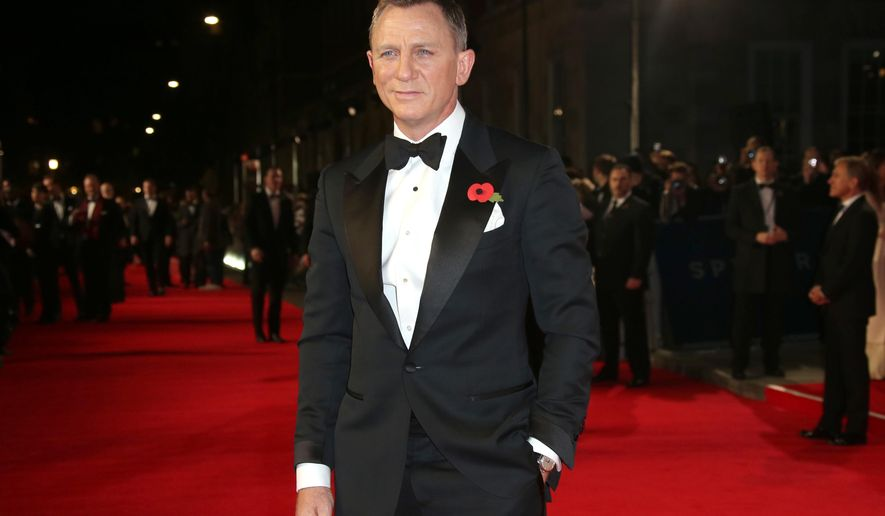 "FILE - In this Monday, Oct. 26, 2015 file photo, Daniel Craig poses for photographers upon arrival for the World Premiere of ""Spectre"" at the Royal Albert Hall in central London. Craig stars as James Bond in the new Bond movie which releases in U.S. theaters on Nov. 6, 2015. (Photo by Joel Ryan/Invision/AP, File)"