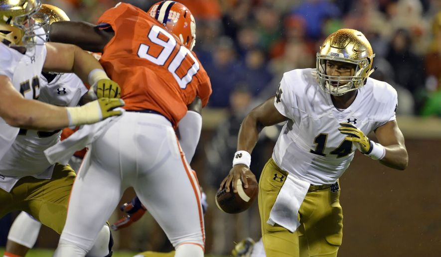 FILE- In this Oct. 3, 2015, file photo, Notre Dame quarterback DeShone Kizer, right, scrambles out of the pocket while pressured by Clemson's Shaq Lawson during the first half of an NCAA college football game in Clemson, S.C. The College Football Playoff committee will release its first rankings of the season Tuesday, Nov. 3, 2015. Notre Dame has some nice wins against USC and at Temple, but the centerpiece of its resume is a 24-22 loss at Clemson in a monsoon. (AP Photo/Richard Shiro, File)