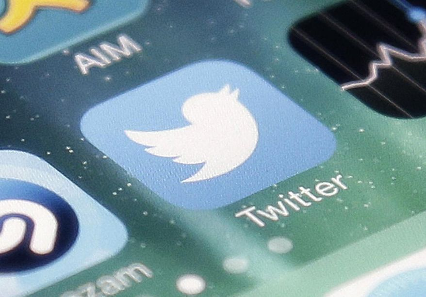 This Nov. 4, 2013, file photo shows the icon for the Twitter app on an iPhone in San Jose, Calif. (AP Photo/Marcio Jose Sanchez, File)