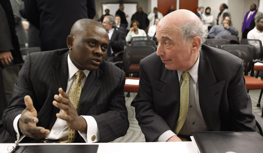 "FILE - In this Jan. 4, 2010, file photo, Dr. Bennet Omalu, left, Co-Director, Brain Injury Research Institute, West Virginia University,  talks with Dr. Ira R. Casson, Neurologist and former co-chairman, NFL Mild Traumatic Brain Injury Committee, before a House Judiciary Committee hearing entitled ""Legal Issues Relating to Football Head Injuries, Part II"" in Detroit. The doctor portrayed in the upcoming football movie ""Concussion"" is on the board of a company looking for a marijuana-based treatment for head injuries. Bennet Omalu was recently named to the scientific advisory board of Kannalife Sciences, which has been developing marijuana-based products to treat the effects of concussions. (AP Photo/Paul Sancya, File)"