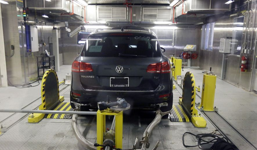 A Volkswagen Touareg diesel is tested in the Environmental Protection Agency's cold temperature test facility in Ann Arbor, Mich., in this Oct. 13, 2015, file photo. (AP Photo/Carlos Osorio, File)