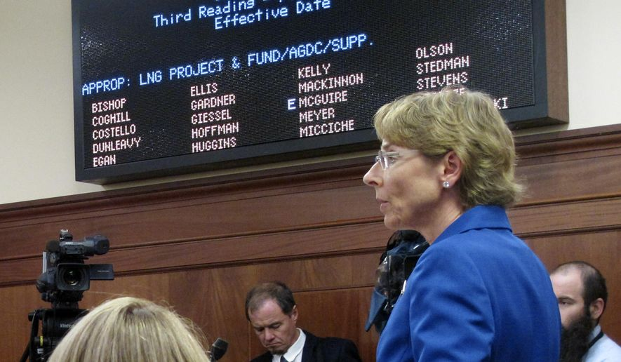 State Sen. Cathy Giessel, right, speaks on the floor of the Alaska Senate during debate on a bill to authorize the buyout of one of the state's partners in a proposed gas project, Tuesday, Nov. 3, 2015, in Juneau, Alaska. The bill passed the Senate 16-3. (AP Photo/Becky Bohrer)
