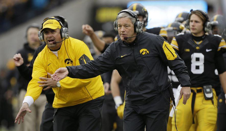 Iowa head coach Kirk Ferentz directs his team during the first half of an NCAA college football game against Maryland, Saturday, Oct. 31, 2015, in Iowa City, Iowa. Iowa won 31-15. (AP Photo/Charlie Neibergall)