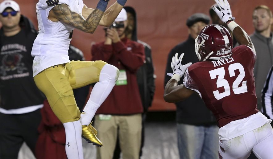 Philadelphia native, Notre Dame wide receiver Will Fuller (7) catches a pass for the winning touchdown in front of Temple defensive back Will Hayes (32) near the end of the second half of an NCAA college football game Saturday, Oct. 31, 2015, in Philadelphia. (AP Photo/Mel Evans)
