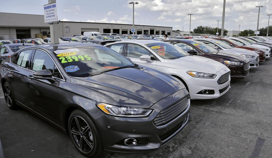 A car salesman works the telephone while searching through inventory at the certified used car lot at Brandon Ford in Brandon, Fla. on Tuesday, Nov. 3, 2015. Sales of new cars and trucks rose by double-digit percentages at most major automakers in October, and companies are raising their expectations for the rest of the year. Ford now expects total U.S. sales of 17.4 million this year, just topping the record of 17.35 million from 2001. (AP Photo/Chris O'Meara)