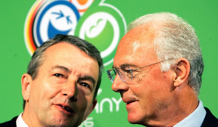 FILE - In this March 6, 2006 file photo German soccer legend and head of the organizing committee Franz Beckenbauer talks to Wolfgang Niersbach during the FIFA Team-Workshop in Duesseldorf, western Germany. German authorities are searching the premises of the country's soccer federation over payments made to FIFA in connection with the 2006 World Cup. (AP Photo/Frank Augstein)