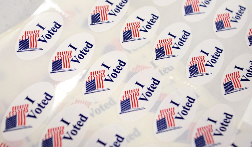 "In this June 3, 2014, file photo, ""I Voted"" stickers sit on the registration table at the Canyon Lake Senior Center polling place in Rapid City, S.D. (AP Photo/Toby Brusseau, File)"