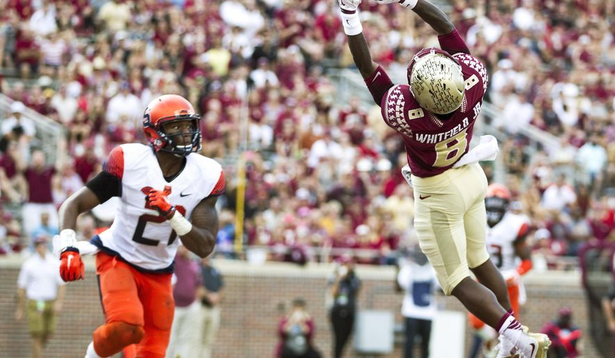 Florida State wide receiver Kermit Whitfield can't hang on to a pass in the endzone as Syracuse safety Chauncey Scissum looks on in the second half of an NCAA college football game in Tallahassee, Fla., Saturday, Oct. 31, 2015.  Florida State defeated Syracuse 45-21. (AP Photo/Mark Wallheiser)