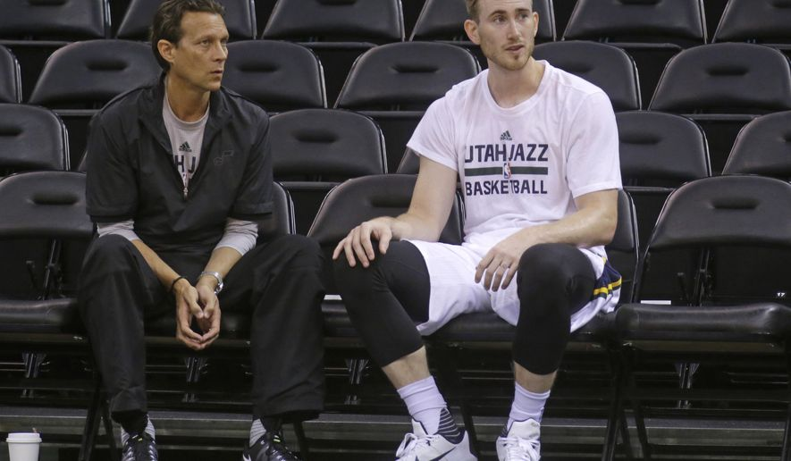 FILE - This Oct. 22, 2015, file photo, shows Utah Jazz head coach Quin Snyder and Utah Jazz guard Gordon Hayward, right, talking during practice before the start of their NBA preseason basketball game against Denver Nuggets, in Salt Lake City. Hayward is off to a slow start in a year he expected to prove he's one of the best of the game. The Jazz are not the slight bit worried about their star with the home opener against the Trail Blazers on Wednesday. (AP Photo/Rick Bowmer, File)