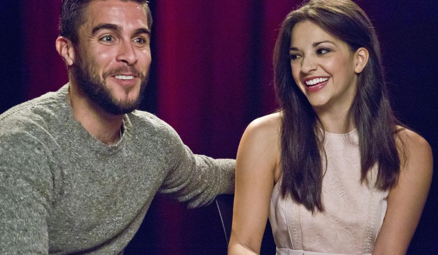 "In this Oct. 15, 2015 photo, actors Josh Segarra, left, and Ana Villafane, of the Broadway bio-musical ""On Your Feet!,"" appear during an interview in New York. Segarra and Villafane star as Cuban-American power couple Gloria and Emilio Estefan, opening Thursday, Nov. 5.  (AP Photo/Bebeto Matthews)"