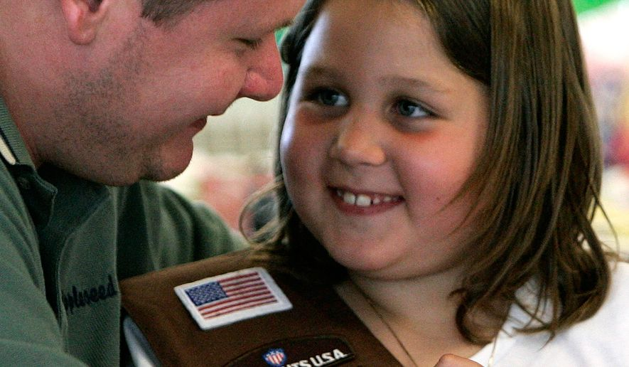 Jamie, 7, smiles as she looks at her father James during a visit by her Girl Scout troop to see their dads at the Allen Correctional Institution in Lima, Ohio on Wednesday, June 14, 2006. The Appleseed Ridge troop is composed of 11 girls whose fathers are all  serving time in the prison.  Once a month, they hold their meetings at the prison with their dads. (AP Photo/Amy Sancetta)