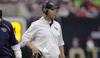 Tennessee Titans head coach Ken Whisenhunt watches from the sidelines during the first half of an NFL football game against the Houston Texans, Sunday, Nov. 1, 2015, in Houston. (AP Photo/Patric Schneider)
