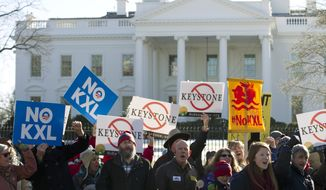 Demonstrators rally outside the White House in Washington on Jan. 10, 2015, in support of President Obama's pledge to veto any legislation approving the Keystone XL pipeline. (Associated Press) **FILE**