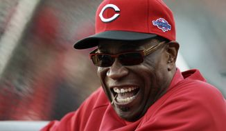 FILE - This Oct. 6, 2012 file photo shows Cincinnati Reds manager Dusty Baker laughing before Game 1 of the National League division baseball series between the San Francisco Giants and the Reds, in San Francisco. (AP Photo/Eric Risberg, File)