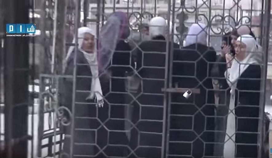 Women loyal to Syrian President Bashar Assad were captured and paraded in cages by the Army of Islam rebel group. (Image: screen grab YouTube)