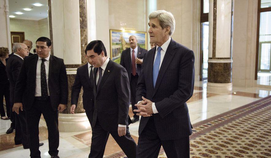 U.S. Secretary of State John Kerry, right, arrives for a meeting with Turkmenistan's President Gurbanguly Berdimuhamedov at the Oguzkhan Presidential Palace in Ashgabat Tuesday, Nov. 3, 2015. (Brendan Smialowski/Pool Photo via AP)