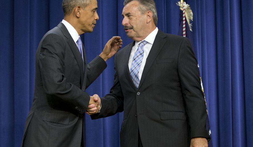 FILE - In this Oct. 22, 2015, file photo, President Barack Obama shakes hands with Los Angeles Police Department Chief Charlie Beck during a forum on criminal justice reform in Washington. The Los Angeles Police Department will collect and report more extensive data about cases in which officers use force, Beck said Tuesday, Nov. 3, 2015. (AP Photo/Pablo Martinez Monsivais, File)