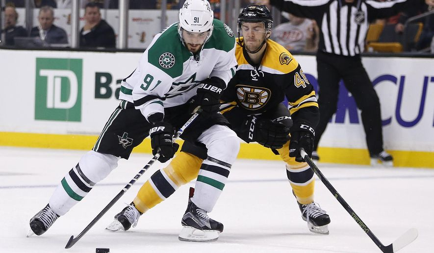 Dallas Stars' Tyler Seguin (91) brings the puck up in front of Boston Bruins' Colin Miller (48) during the first period of an NHL hockey game in Boston, Tuesday, Nov. 3, 2015. (AP Photo/Michael Dwyer)