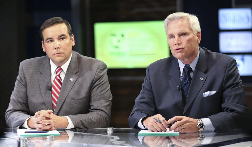 In this photo taken, Tuesday, Oct. 20, 2015, Columbus mayoral candidates Andrew Ginther, left, and Zach Scott, participate in a debate at WBNS 10TV in Columbus, Ohio. (Fred Squillante/The Columbus Dispatch via AP) MANDATORY CREDIT