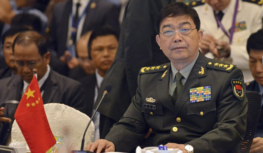 China's Defense Minister Chang Wanquan, right, sits before the start of the Association of Southeast Asian Nations (ASEAN) Defense Ministers' Meeting Plus in Kuala Lumpur, Malaysia, Wednesday, Nov. 4, 2015. (AP Photo)